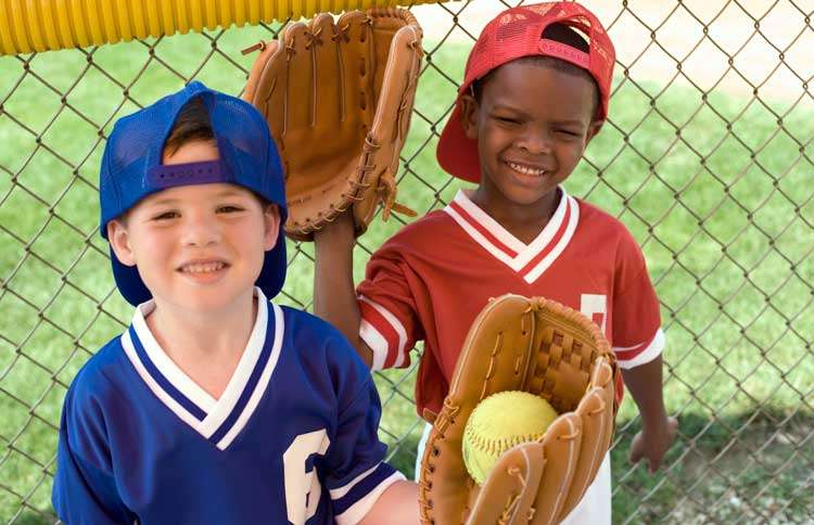 Guideposts: Two boys sporting baseball uniforms and oversized baseball gloves