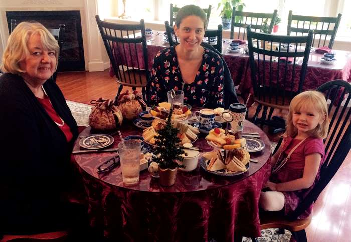 Series author Elizabeth Adams (center) enjoys afternoon tea with her mother and daughter.