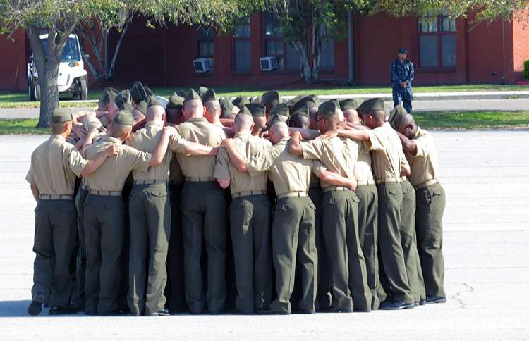 Guideposts: A platoon of Marines gather together for one final prayer after their graduation ceremony at the United States Marine Corp Military Training Base at Parris Island, SC.
