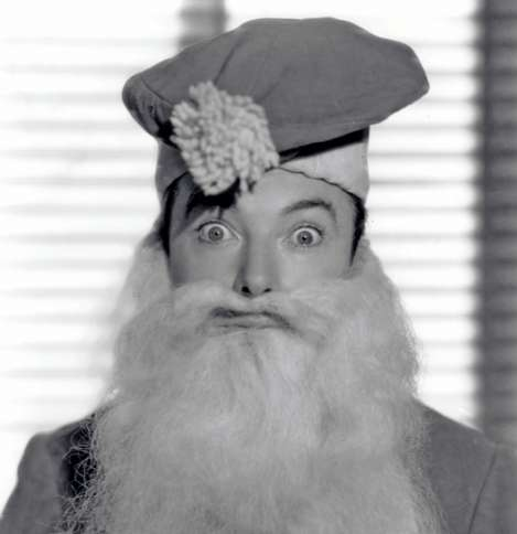 Guideposts: Musical comedy star Jack Haley gives a little ho-ho-ho as a bug-eyed Santa Claus