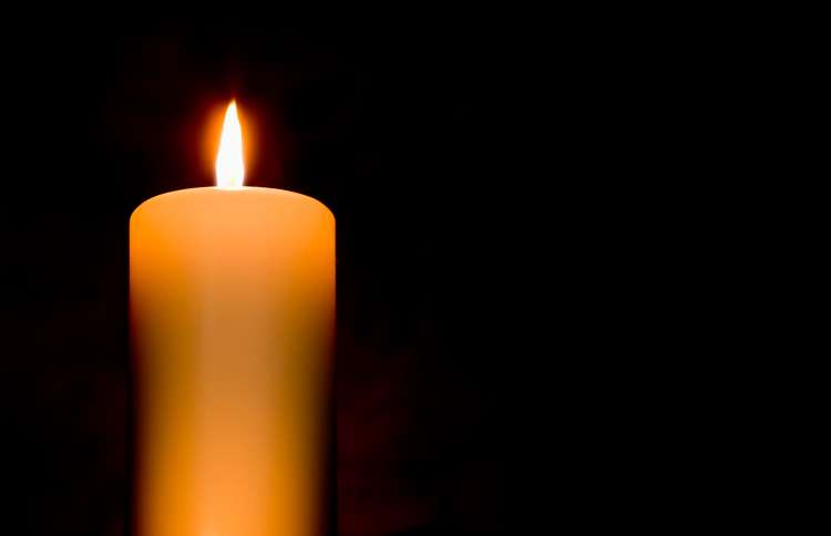 Guideposts: A lit candle brighten a darkened room
