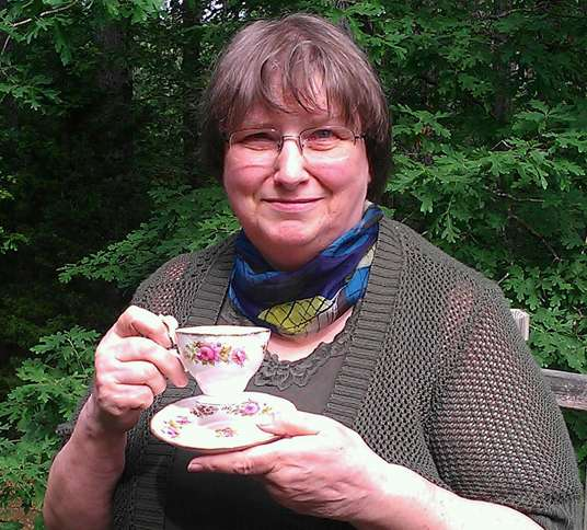 Series author Susan Page Davis, who conceived of the Tearoom  Mysteries series, poses with a teacup that belonged to her mother.