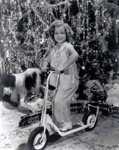 Guideposts: Bubbly child star Shirley Temple enthusiastically celebrates Christmas Day.
