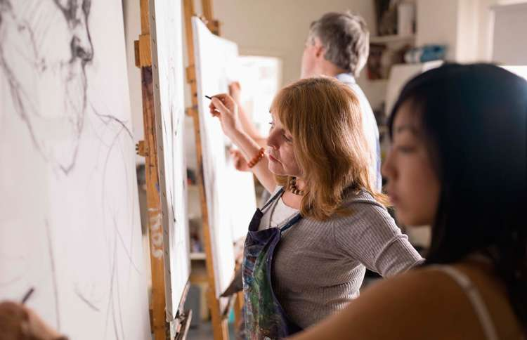 Woman taking a summer painting class