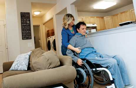 Dana assists Michael in navigating their home.