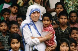 Mother Teresa, surrounded by young children
