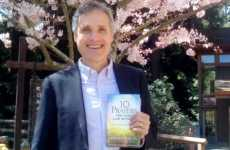 Rick Hamlin holds his new book 10 Prayers You Can't Live Without