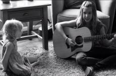 Middle schooler Abby Miller with her guitar and a friend