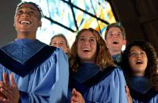 A choir sings joyfully.