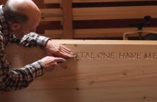 Marcus Daly works at handcrafting a coffin.