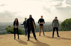 The five members of Pentatonix sing a capella in the open air.