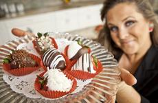 Shari Fitzpatrick holding chocolate-covered strawberries