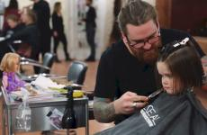 Little girl gets her hair cut