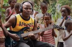 "A guitarist in Africa takes part in a recording of ""La Bamba."""