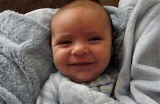A grinning infant named Oliver