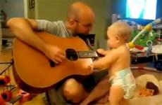 A toddler rocks out to her father's rendition of a Bon Jovi song.