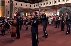 A flash mob composed of military musicians performs.