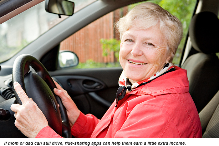 A smiling senior woman behind the wheel of her car